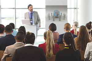 Business people listening to a business presentation